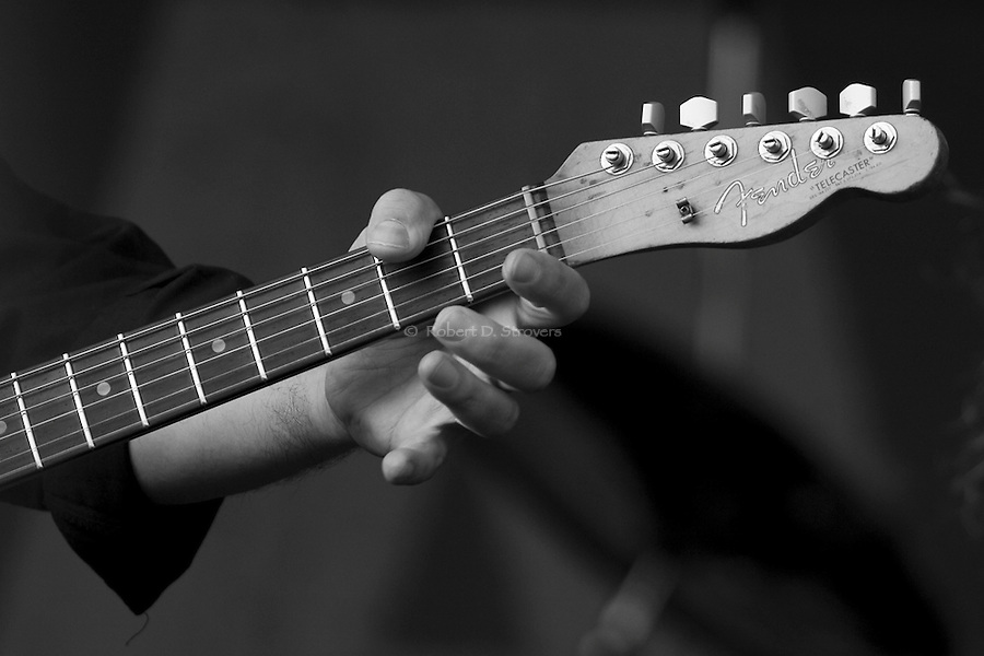 Guitars, Saxes, Horns and More - plus the hands that play them. Musical instruments on stage and in hand. Musicians and their tools of the trade.