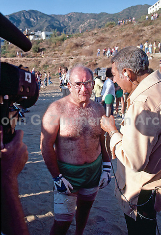 Actor Ed Asner interviewed by Howard Cosell at the Battle of the Network Stars. Pepperdine University, Pepperdine CA. November, 1979. Photo by John G. Zimmerman.