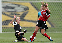 BOYDS, MARYLAND - July 21, 2012:  Joanna Lohman (17) of DC United Women slides into Jamie Clark (23) of the Virginia Beach Piranhas during a W League Eastern Conference Championship semi final match at Maryland Soccerplex, in Boyds, Maryland on July 21. DC United Women won 3-0.