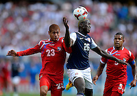 Chicago, IL - Sunday July 28, 2013:   USMNT forward Eddie Johnson (26) battles with Panama's Robert Chen (23) during the CONCACAF Gold Cup Finals soccer match between the USMNT and Panama, at Soldier Field in Chicago, IL.