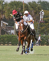 WELLINGTON, FL - APRIL 15:  Agustin Obregon of Palm Beach Illustrated hits a neck shot in the $100,000 World Cup Final, at the Grand Champions Polo Club, on April 15, 2017 in Wellington, Florida. (Photo by Liz Lamont/Eclipse Sportswire/Getty Images)