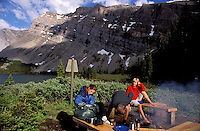 CANADA, ALBERTA, KANANASKIS, MAY 2002. Sunset over Ribbon lake campsite between the snowy mountains.  The Kananaskis Country provincial park is home to Canada's most beautiful nature and wildlife. It has also escaped the mass tourism as in Banff National Park. Photo by Frits Meyst/Adventure4ever.com