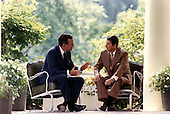 Washington, D.C. - July 7, 1988 -- United States President Ronald Reagan and Vice President George H.W. Bush confer on the Colonnade of the White House in Washington, DC on July 7, 1988 just before attending a lunch with political advisors on campaign strategy..Credit: White House via CNP