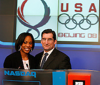 Sanya Richards (Left) poses with Robert Greifeld(Right) President, CEO NASDAQ @ the Market site @ the closing bell on Wednesday, January 2, 2008. Photo by Errol Anderson.
