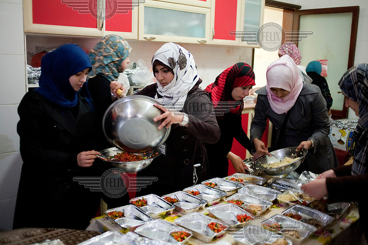 Women who have volunteered make food for rebels at Mufeeda Al Masri's school in Benghazi. On 17 February 2011 Libya saw the beginnings of a revolution against the 41 year regime of Col Muammar Gaddafi..