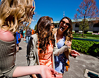LEXINGTON, KENTUCKY - APRIL 08: Fans share a laugh by the paddock on Blue Grass Stakes Day at Keeneland Race Course on April 8, 2017 in Lexington, Kentucky. (Photo by Scott Serio/Eclipse Sportswire/Getty Images)