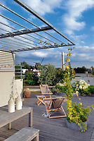 This roof terrace has stunning views towards the Moulin de la Galette and the planting, which was inspired by English gardens, results in flowers from April to October