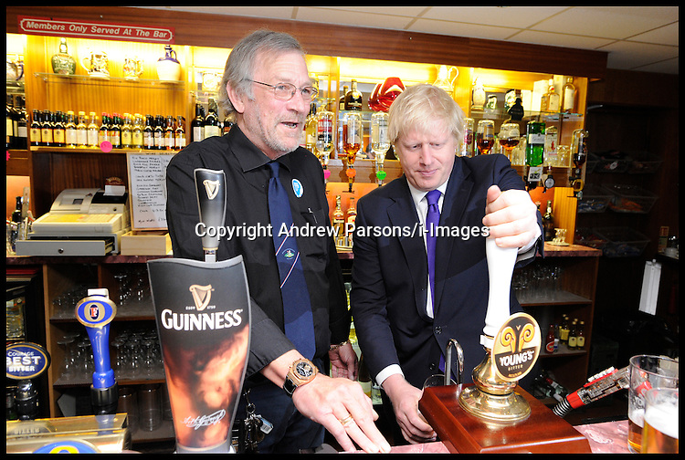 London Mayor Boris Johnson with this brother Jo Johnson at the Orpington Conservative Association Club after Boris's rally, Tuesday April 17, 2012. Photo By Andrew Parsons/I-images