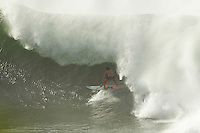 Pipeline, Haleiwa, Oahu, Hawaii (Friday January 21, 2011) .The 10'-15' west swell continued to hit the North Shore today with Pipeline being one of the only places to surf with Second Reef Pipeline breaking on the bigger sets. .Photo: joliphotos.com