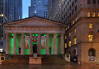 Federal Hall National Memorial, designed by John Frazee in Neoclassical style and built 1842 as the United States Custom House, on Wall St, Manhattan, New York, New York, USA. The building replaces the original Federal Hall, demolished in 1812, which was built in 1700 as New York's City Hall, and was the first capitol building of the USA under the Constitution, site of George Washington's inauguration and the US Bill of Rights in the First Congress. The building is now run by the National Parks of New York Harbor. Picture by Manuel Cohen