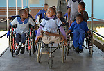 Students move along a hallway at the Jairos Jiri School in Harare, Zimbabwe. In the middle in a wheelchair is Anishah Masaire, 11.