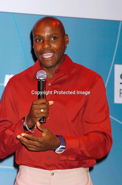 Carl Lewis ..at the Swatch and Microsoft launch of a new watch line called Paparazzi on October 20, 2004 at The Supper Club. ..Photo by Robin Platzer, Twin Images
