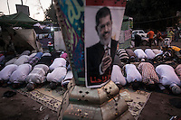 In this Thursday, Aug. 01, 2013 photo, supporters of the ousted president Mohammed Morsi offer prayers at the dusk in the sit-in of Cairo University, in the Giza district. (Photo/Narciso Contreras).