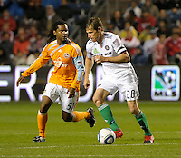 Chicago forward Brian McBride (20) looks to get past Houston's Adrian Serioux (51).  The Chicago Fire defeated the Houston Dynamo 2-0 at Toyota Park in Bridgeview, IL on April 24, 2010.