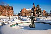 The Howard Fountain on the UVM Green in front of Williams and Old Mill. UVM Winter Campus