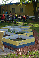 NWA Democrat-Gazette/BEN GOFF @NWABENGOFF<br /> Vegetables grow in planter beds built by local Eagle Scouts Monday, May 15, 2017 during a ribbon-cutting for the new outdoor classroom at Northside Elementary School in Rogers. The school took the oportunity to thank the Rogers Public Education Foundation and local businesses including Lowe's Home Improvement, Milestone Construction Company and Gall Excavation Inc. which made the project possible. The outdoor classroom was complemented by raised planting beds and benches made by local Eagle Scouts, and a butterfly garden built by teachers.