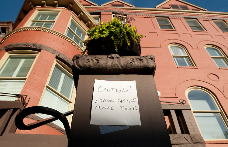 UNITED STATES - AUGUST 23: A sign alerts residents that the brick facade of this residential building was damaged during the 5.8 earthquake in Washington on Tuesday, Aug. 23, 2011. The buidling is on Vermont Avenue, NW, several blocks away from the White House. (Photo By Bill Clark/Roll Call)