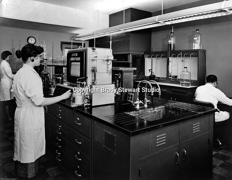 Client: Calgon<br /> Ad Agency: William W Mathews Company<br /> Product: Calgon Water Treatment Systems<br /> Location: HK Porter Building in Pittsburgh<br /> <br /> View of Calgon chemists and technicans testing water treatment systems in the HK Porter Building laboratory.