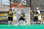 10 April 2011: University at Albany Great Dane goalkeeper John Carroll, a Junior from Nesconset, NY, defends his net against the attack of University of Vermont Catamount A.J. Masson, a Sophomore from Newmarket, Ontario, during game action at Moulton Winder Field in Burlington, Vermont. The Catamounts defeated the visiting Danes 11-6 in America East play. Mandatory Credit: Ed Wolfstein Photo