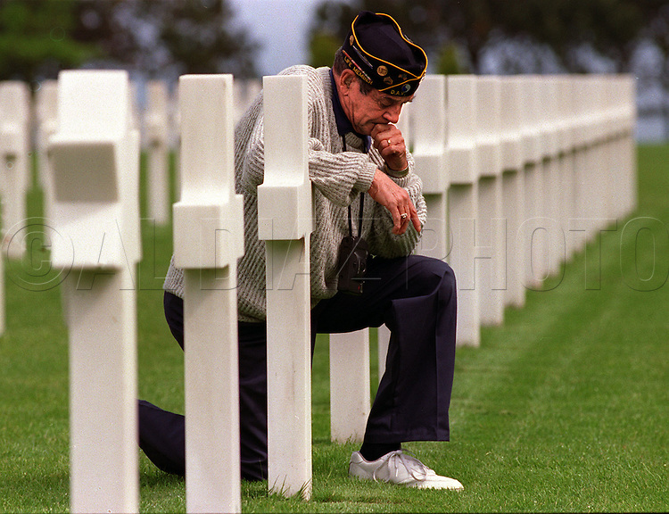George Treano rested his arm on a tombstone of a friend buried at Normandy American Cemetery in Normandy, France on the 50th Anniversary of the allied invasion of on D-Day. His son Robert said, I've never...seen...my father cry.