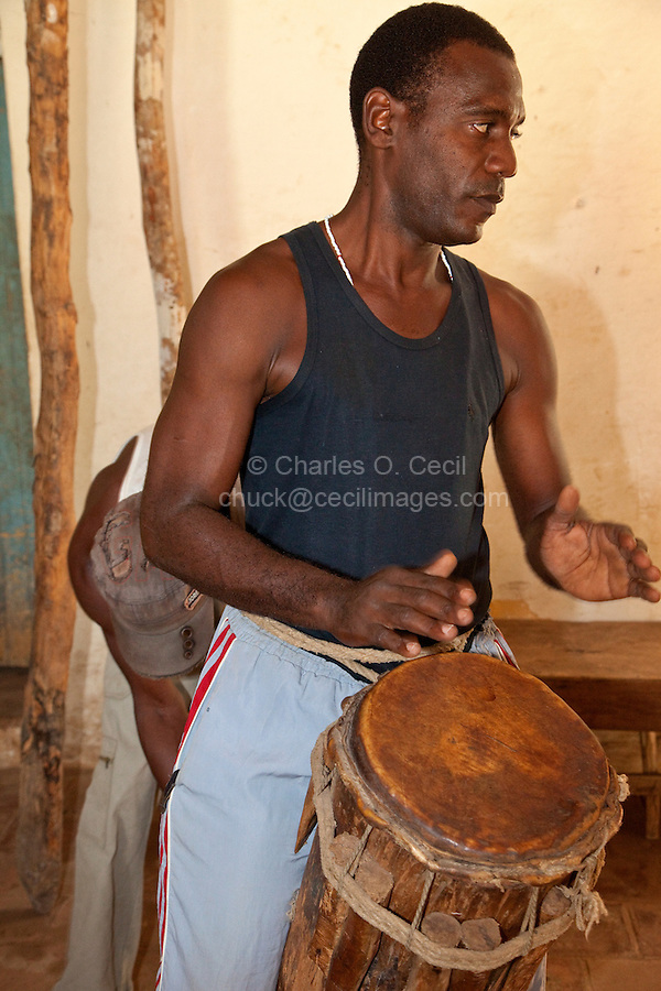 Cuba, Trinidad.  Drummer in Afro-Cuban Religious Ceremony of Congolese Origin.