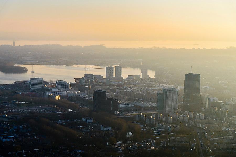 Nederland, Flevoland, Almere, 14-02-2017;  Almere-Stad, winters stadsgezicht, stadshart bij zinsondergang. Weerwater in de achtergrond<br /> Almere City, winter cityscape, city heart.<br />  <br /> luchtfoto (toeslag op standard tarieven);<br /> aerial photo (additional fee required);<br /> copyright foto/photo Siebe Swart