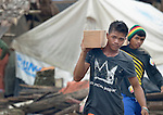 Men carry lumber to be used in the construction of temporary houses on Jinamoc Island, part of the municipality of Basey in the Philippines province of Samar that was hit hard by Typhoon Haiyan in November 2013. The storm was known locally as Yolanda. The ACT Alliance has been providing a variety of forms of assistance to survivors here, including a cash for work program that pays local residents to saw up downed and damaged coconut trees to provide lumber for shelter construction. Coordinated by the National Council of Churches in the Philippines, the recovery program includes shelter construction, livelihood generation, reforestation, and assistance to women's and farmers' groups. Finn Church Aid will assist with school construction, and Norwegian Church Aid will help residents build permanent comfort rooms (toilets).