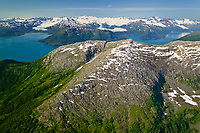 Aerial of granite ridge in the Chugach mountains bordering Passage Canal, in Prince William Sound, Alaska