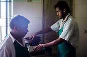 Workers prepare the oil for Abhyanga (full body oil ayurvedic treatment) at the National Research Institute of Panchakarma in Cheruthuruthy in Thissur district of Kerala, India.