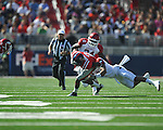 Ole Miss' Nickolas Brassell(2) vs. Arkansas safety Tramain Thomas (5) and Arkansas linebacker Jerry Franklin (34) at Vaught-Hemingway Stadium in Oxford, Miss. on Saturday, October 22, 2011. .