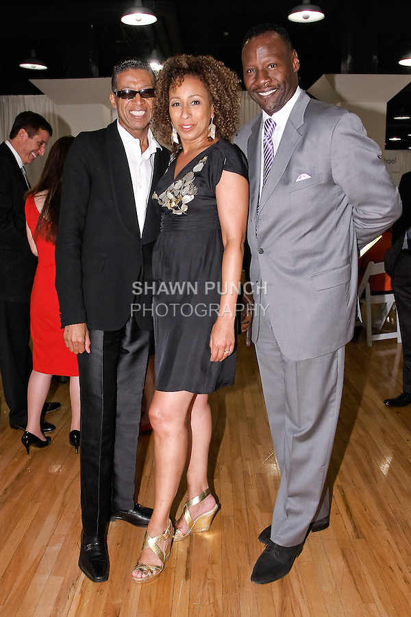 Fashion designer b michael (left), actress Tamara Tunie, and her husband Jazz Vocalist Gregory Generet (right), pose together after the b michael AMERICA Couture Spring 2012 runway show, during Mercedes-Benz Fashion Week Spring 2012; Septeber 24 2011.