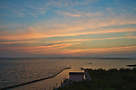 Colorful clouds appear over the Currituck Sound after sunset