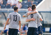 Alex Muyl (9) of Georgetown is congratulated on his goal by teammate Tom Skelly (17) at Shaw Field in Washington, DC.  Georgetown defeated Seton Hall, 8-0.