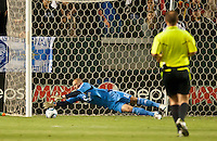 CARSON, CA – June 3, 2011: LA Galaxy goalie Josh Saunders (12) dives to make a save during the match between LA Galaxy and DC United at the Home Depot Center in Carson, California. Final score LA Galaxy 0, DC United 0.