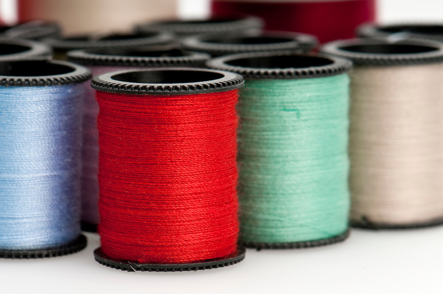 Close up of thread bobbins. Macro shot with use of selective focus.