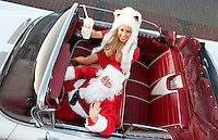 07/12/11 ***NO REPRODUCTION FEE***Model Tiffany Stanley pictured with Santa in a 1958 Buick at Eddie Rockets Diner, Walkinstown this morning where she launched the Eddie Rocket's Christmas Pudding Shake, which goes on sale at City Dinners and Shake Shops nationwide today..The shake includes three scoops of 100% Irish Ice Cream and a chunk of Plum Pudding, hand dipped and topped with Whipped Cream and Cinnamon,.Every time  a Christmas Pudding Shakeis bought  in December, Eddie Rockets franchisees will donate EUR1 to Irish Osteoporosis Society which faces closure this year if they do not receive urgent funding..The Christmas Pudding Shake is joined on Eddie Rocket's festive menu by another seasonal treat, Christmas Cake Pops, which can be had for EUR3.50...***NO REPRODUCTION FEE***..Picture Colin Keegan, Collins, Dublin.