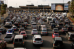 Cars line up to enter the U.S. in Tijuana, Mexico on Saturday, March 26, 2005.<br />