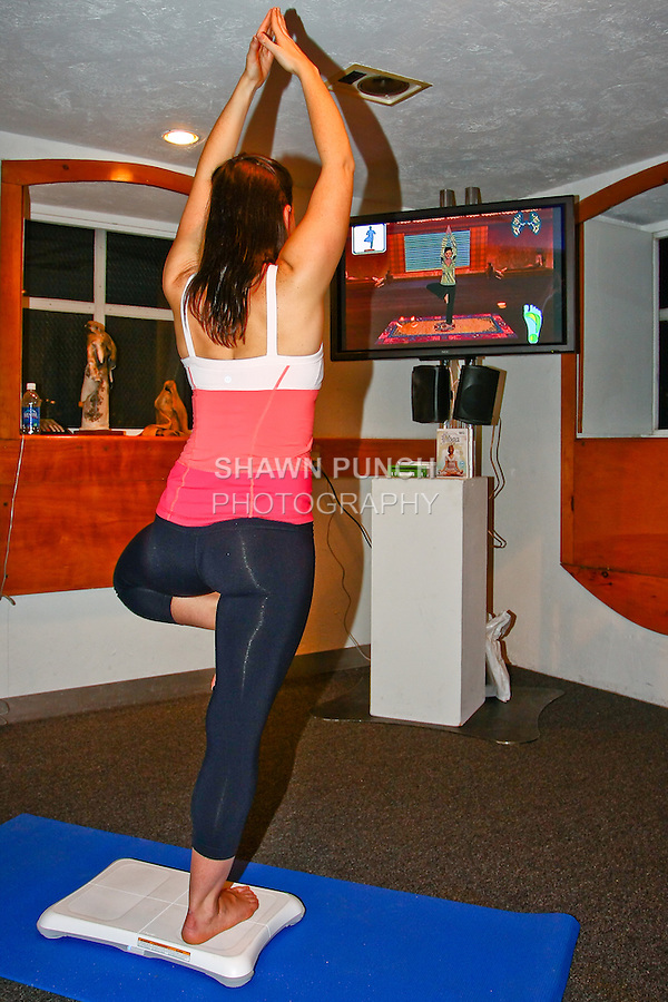 Jewel Elizabeth demonstrats how to us  Yoga for Wii. Photographed during Yoga for Wii video game launch, 463 West Street, Ramscale Loft, November 9 2009.