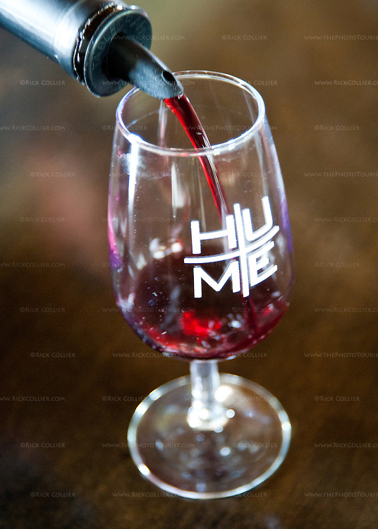 A taste of red wine is poured into my glass at Hume Vineyards.