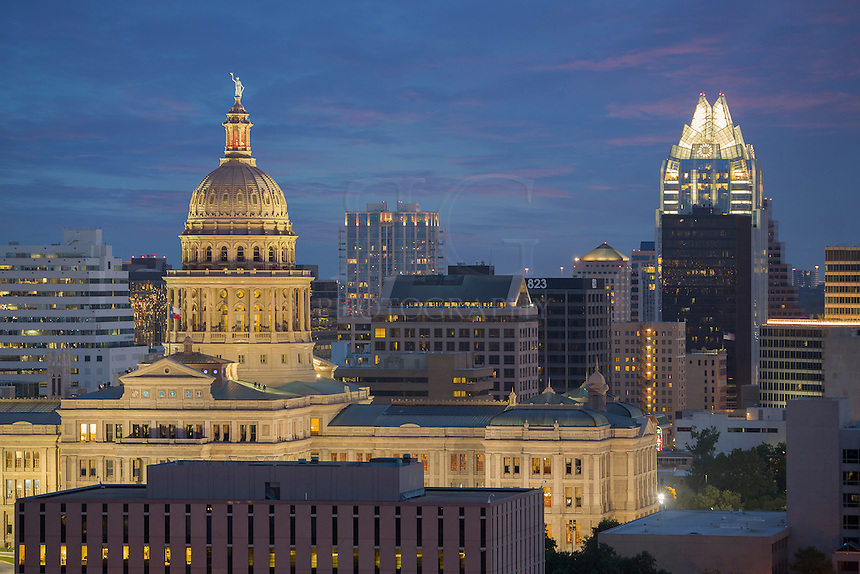 Both the Texas State Capitol and the Austonian appear in this image from downtown Austin. These iconic high rises are well known in the skyline that features many distinct buildings.