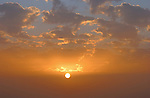 Round orb of the sun against the clouds at sunset..Tenerife Canary Islands.