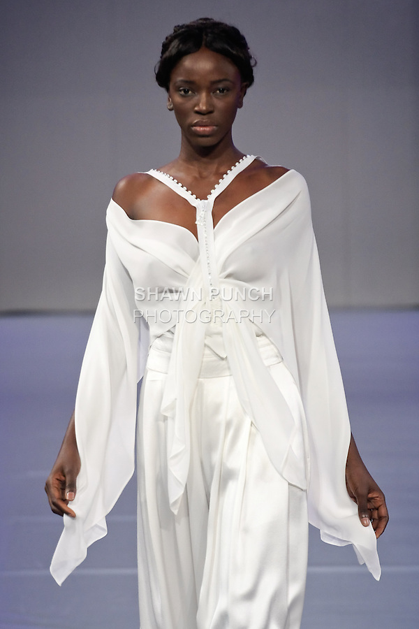 Model walks the runway in an outfit by London based designer Romero Bryan, during Couture Fashion Week Spring 2012.