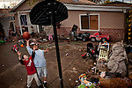 Ten-year-old Benito Tirjeron, left, and his friend, Edward Gutierrez, 11, right, play basketball at his home in the Parklawn neighborhood of Modesto, Calif., March 1, 2012.