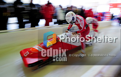 18 December 2010: Gregor Baumann pushes his 2-man bobsled for Switzerland, finishing in 12th place at the Viessmann FIBT World Cup Bobsled Championships on Mount Van Hoevenberg in Lake Placid, New York, USA. Mandatory Credit: Ed Wolfstein Photo