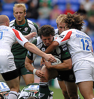 Reading, GREAT BRITAIN,  Exile Declan DANAHER, looking for the gap between, left, Steve JONES and Joe SHAW, during the Guinness Premiership match London Irish vs Newcastle Falcons, at Madejski. England, Sun. 23.09.2007  [Mandatory Credit, Peter Spurrier/Intersport-images].....