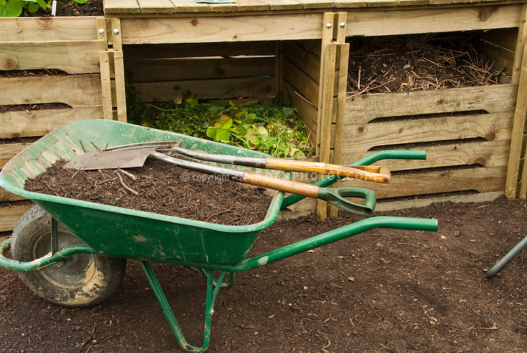 Compost Bin with Wheelbarrow, garden tools, composted materials in 3 stagees
