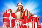 Smiling young woman with Christmas gifts