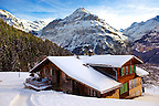 Mountain chalet in winter looking towards the Jungfrau mountain. Grindelwald, Swiss Alps