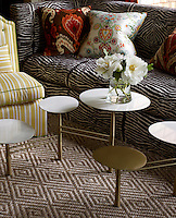 Detail of the circular tiers of the Anthony Todd Homeware table in the living room