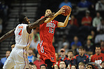Ole Miss' Anthony Perez (13) vs. Florida's Patric Young (4) in the SEC championship game at Bridgestone Arena in Nashville, Tenn. on Sunday, March 17, 2013.